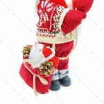 عروسک بابانوئل و چوب اسکی