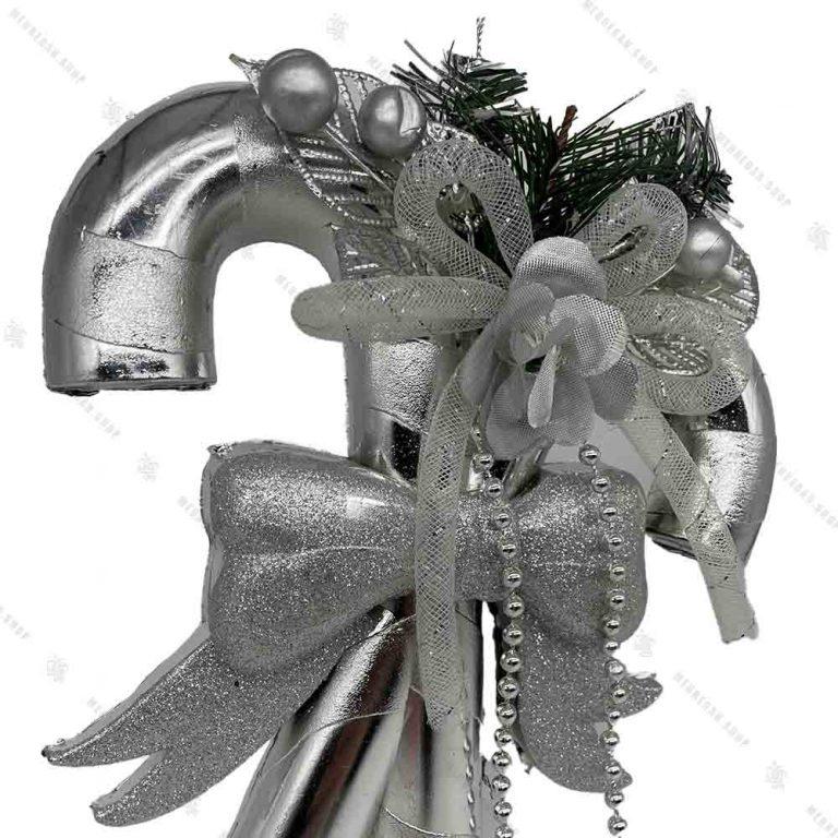 آویز کریسمس مدل عصا و پاپیون نقره ای