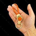 جاسوئیچی بند چرمی نارنجی هانست Honest